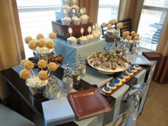 """My first try at a dessert table designed for my son's """"Meet the Baby"""" party.  My goal was to have a lot of height and for all treats to be seen and easily accessed for enjoyment."""