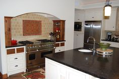 Love the cabinet makers choice of old walnut accents that he did to offset the cool accent tile backsplash!  This was a fabulous kitchen to cook in!