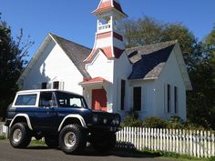 Beautiful Blue Early Bronco.  The church adds some godly character to a devilish vehicle!!!!