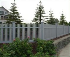 Elevated Nantucket Fence - Our elevated Nantucket fence in factory painted cellular vinyl promises years of handsome good looks with little maintenance. An added attraction is the optional fascias and kickboard