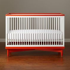 Could paint the base of a {cheaper} crib a bright color.  Oslo Crib | The Land of Nod