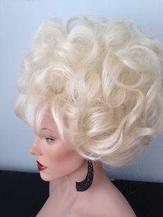 Oversized blonde, updo drag wig