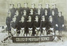 """Ida Scherf was one of the first graduates of the """"College of Mortuary Science"""" at Pensacola Naval Air Station. The sign was a spoof on the killing ability of the Browning .50 caliber machine-gun perched on either end of the banner. She is the last WAVE at the far right in the second row standing Photo provided ~"""