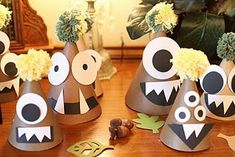 Monster-themed paper party hats