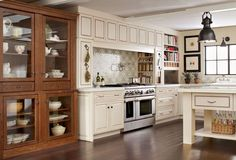 Quaint decor with a European twist, this kitchen is packed with modern amenities from the cutlery drawer dividers to pantry pullouts.