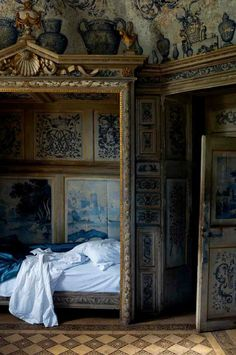 Royal blue, antique painted paneled bedroom