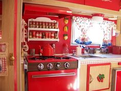 Love this red  kitchen in a vintage 1969 trailer