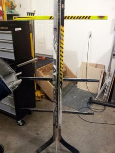 Why didn't i think of this when all our sticks broke or were too small?  equipment rack made of hockey sticks