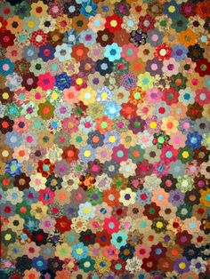 Like this Erica?  Absolutely beautiful!! Can't even begin to imagine how much work goes into this!!  Grandmother's Flower Garden quilt