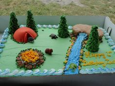 Camping party cake.  This is the cake I created to fit our party theme.  Everything is eatable except for the little animals which the birthday boy can save to play with when he is a little older.  The waterfall and tent were made out of Rice Krispy Treats and then covered with fondant icing.  The trees are ice cream cones decorated with icing.