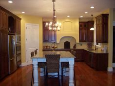 yellow with Cherry Cabinets in the kitchen....use the DIY staining tutorial for the oak cabinets to get this look.