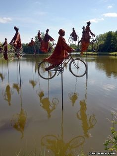 A sculpture entitled, Retour a Betton, by French artist Guy Lorgeret in Rennes represents people on bicycles migrating from one bank to another.