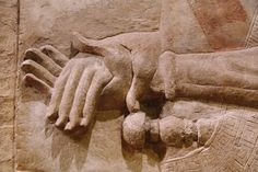 From Khorsabad - Ancient Mesopotamia. Detail of hands from relief sculptures that once lined the throne room façade in the palace of the Assyrian king Sargon II, who ruled from 721-705 B.C. |   Oriental Institute Museum at the University of Chicago