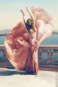 Flowy blush-colored gown, romantic hair