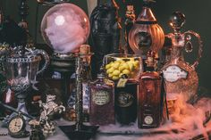 DIY Harry Potter Potion Display for Halloween: Dumbledore's office - Scrapbook.com- Get ready for a spooky Harry Potter Halloween! Grab some old bottles and dress them up with inks, charms, embellishments, paper and glitter!
