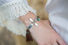 Hand crafted cross with tassel bracelet.