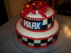 "Stacked Nascar Birthday Cake - This cake was for a 30th birthday party.  They didn't want it to end up ""juvenile,"" tricky with the theme.  When I delivered it, I put on a few of their decorations.  When I get that picture, I'll replace this one with that.  The cake is covered with rolled fondant.  The bow is rolled fondant mixed with gum tex.  I made the name out of fondant as well."