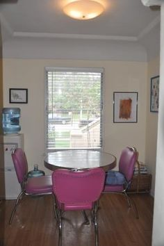 The centerpiece of the room, a 50s reproduction Formica top kitchen table with handle-back chairs, had served its time.  The set up was snug with two chairs, but with the addition of a child, playdates and visiting grandparents, the need grew for more seating, and four chairs was a crowd.