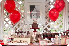 red and brown cardboard box first birthday party dessert table