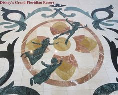 Peter Pan inlay in the marble floor in the lobby at Disney's Grand Floridian Resort.  For more resort photos, see: http://www.buildabettermousetrip.com/disneys-grand-floridian   #PeterPan #GrandFloridian #Disneyworld #WDW