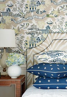 Luzon #wallpaper in #navy & #beige Ridgewood Headboard from #ThibautFineFurniture in Etosha Embroidery #fabric in #taupe Pillows in Luzon #fabric in #navy & #beige. Pillows in Zambia Embroidery #fabric in #navy. #Thibaut