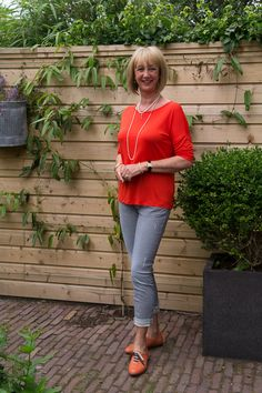 ORANGE BROGUES!! Cute rolled jeans with flats look.