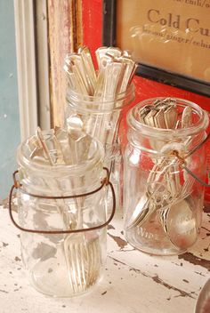 storing silverware in mason jars -- this idea is for parties but I do it at home. I keep all of the adult silverware in one jar and the kids silverware in another. So cute :)
