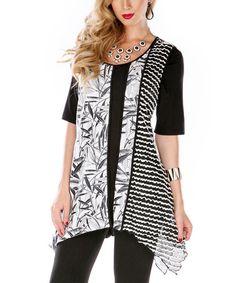 Loving this Black & White Ruffle Handkerchief Tunic on #zulily! #zulilyfinds