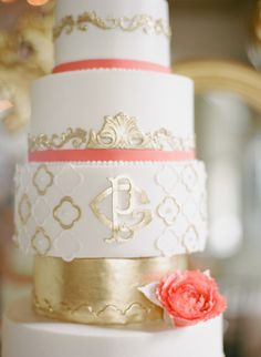White Monogrammed Wedding Cake with Gold Details and Peach Accent #gold #goldwedding #goldweddingcake #whiteweddingcake #weddingcake