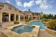 A backyard with a large outdoor infinity edge pool and spa. Heath, TX Coldwell Banker Residential Brokerage $2,275,000
