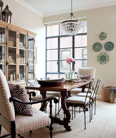 Mostly neutral dining room with a few subtle pops of color