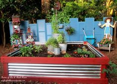 How to make a shutter fence and raised flower bed eclecticallyvintage.com shutter, tin, raised flower beds