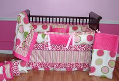 Jade Pink Baby Bedding Set  Included in this custom baby crib bedding set is the ruffled bumper pad, 2 tier ruffled crib skirt, and soft minky backed blanket.  The colors are bright white and various shade of greens and pinks.