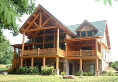 Lake Anna, West Virginia, 2830 sq ft Douglas fir post and beam, scribed log rafters over porches, handcrafted railings.