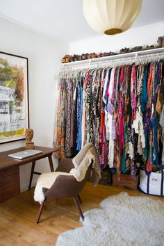 photo tour of a bohemian-feeling home. i love how she stores her flats in a basket and her boots above her hanging clothes. gives me hope for my closet situation.