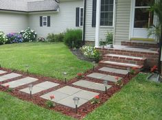 Front Walkway built out of inexpensive cement pavers, red lava rocks, and solar lights