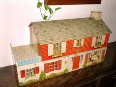 I had a metal doll house - looked just like mine. :)