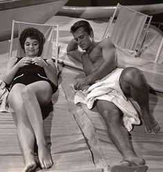 1961: Robert Conrad & Karyn Kupcinet on a Warner Brothers soundstage beach shooting Hawaiian Eye (1959-1963, ABC)
