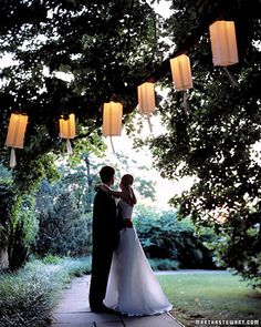 Paper Lantern Decorations DIY by Martha Stewart: Simply made of nested paper bags and electric Christmas tree lights. So romantic!