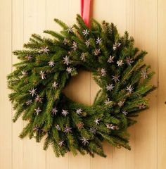 Whole star anise looks lovely on an evergreen wreath. How-to plus more wreath ideas: http://www.midwestliving.com/homes/seasonal-decorating/beautiful-holiday-wreaths/?page=17,0