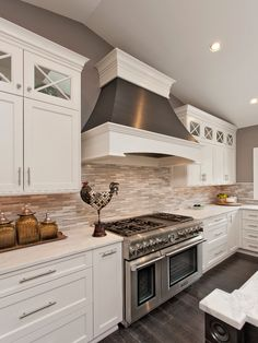 Wow. WOW. WOW.  Beautiful kitchen with pencil tile backsplash. love the dark floors and wall color