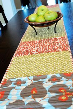Make a Table Runner by sewing (or gluing :) placemats together. Add trim to the edges. Im adding this to my list of rainy day projects!