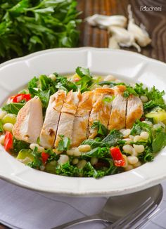 Healthy Chicken Abruzzi Recipe -- Chicken breast in a savoury broth of cannellini beans, kale and garden vegetables. Olive Garden Restaurant copycat recipe.