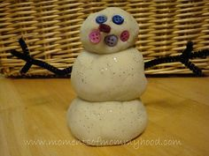 add glitter to your uncolored salt dough recipe for some snow dough! Maybe present with different things that might inspire snowman play... buttons, pipe cleaners, baby carrots...