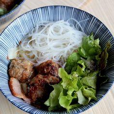 In Hanoi, Vietnam, breakfast is Bun Cha: broiled pork patties, fresh herb salad, rice noodles, and a tangy vinegar sauce.