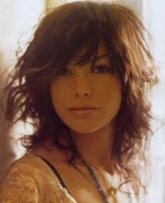 Layered Medium Messy Curly Haircut with Side Bangs - Find more on http://hairstylesweekly.com