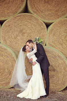 large hay bales as portrait backdrop is so pretty http://www.weddingchicks.com/2014/03/16/georgia-classic-barn-wedding/