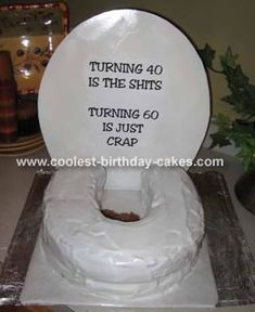 Toilet Birthday Cake: I made this toilet cake for my brother-in-law and nephew for their shared 60th and 40th birthday surprise party. I purchased a Wilton Horseshoe cake pan