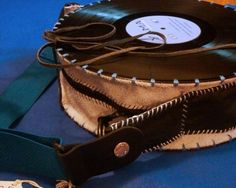 credit: Recycle Art Great purse construction[http://www.recyclart.org/2012/06/yama-wear-music-wear-recycled/]