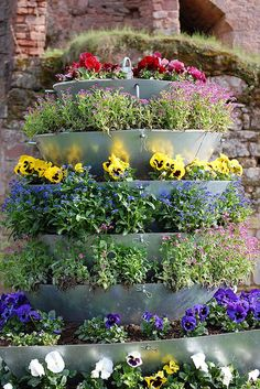 a flower tower is one of those great gardening ideas you could try out!